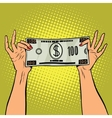 Female hands holding a hundred dollar bill vector image