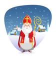 saint nicholas standing in front winter background vector image vector image