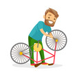 caucasian white man working in the bike workshop vector image