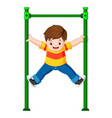 boy is holding monkey bar with his hands vector image vector image