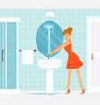 woman in bathroom with broken tap valve