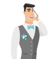 young caucasian groom talking on a mobile phone vector image
