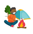 african man roasting marshmallow over campfire vector image