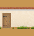 facade with old wooden door grass vector image vector image