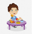 funny smiling cartoon boy eating dinner at table vector image