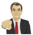 angry mature businessman pointing finger at you vector image vector image
