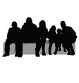 group of people sitting on a stone silhouette vector image vector image