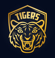mascot of gold tigers head on shield background vector image vector image