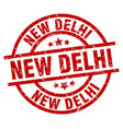 new delhi red round grunge stamp vector image vector image