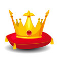 gold crown with precious stones on red pillow vector image vector image