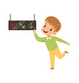 boy pointing finger at traffic light education vector image vector image