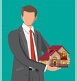 businessman holding house building vector image vector image