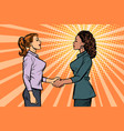 african and caucasian businesswomen shaking hands vector image