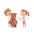children playing cute girl doctor and teddy bear vector image vector image