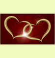 two golden hearts on red velvet vector image vector image