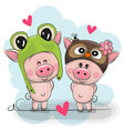 two cute pigs in a frog and owl hat vector image vector image