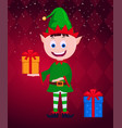 christmas elf with gift smiling character vector image