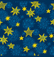 gold star and blue snowflakes seamless pattern vector image
