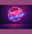 2020 happy new year with neon light alphabet vector image vector image