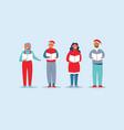 people in santa hats singing christmas carols vector image vector image