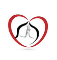 kissing couple in a heart shape logo vector image