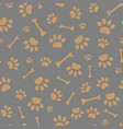 seamless pattern paws and bones vector image vector image