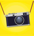 Old photographic camera over yellow background vector image vector image