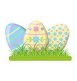 happy easter eggs on grass vector image