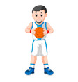 energetic young man playing basketball vector image