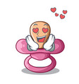 in love cartoon pacifier for a newborn baby vector image vector image