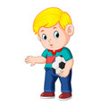 boy standing and holding the ball vector image