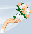 womans hand and throwing wedding bouquet vector image