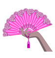 female hand with a pink open fan isolated on white vector image vector image