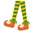 christmas elf legs in striped tights and boots vector image vector image