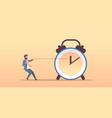businessman pulling clock arrow deadline time vector image