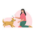 woman is feeding dog owner takes care puppy vector image