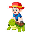 a boy is sitting on a big turtle vector image