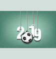 2019 new year and soccer ball hanging on strings vector image vector image