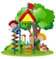 Boys climbing up playhouse in park