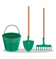 gardening bucket green shovel and rake on white vector image vector image