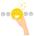 hand with yellow smiley emotional emoji happy vector image