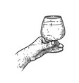 a hand with glass cognac design element vector image