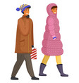 happy smiling man and woman in warm coat walking vector image vector image