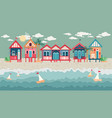 landscape with beach huts in a row vector image