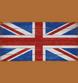 uk flag painted on old wooden planks background vector image vector image