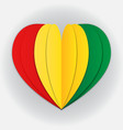 guinea flag paper cut heart independence day vector image
