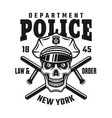 skull in police cap with batons emblem vector image vector image