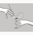 female hands holding a cocktail with an orange vector image