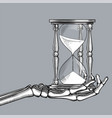 skeleton hand with a retro hourglass vector image