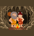cartoon prehistoric caveman couple with cave backg vector image